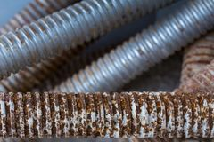 Rusty screw scaffold. Closeup rusty screw scaffold on floor concrete in construction site Royalty Free Stock Image
