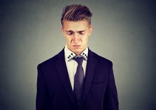 Closeup of a sad crying business man. Closeup of a sad crying young business man looking down royalty free stock images