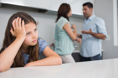 Closeup of a sad girl while parents quarreling Stock Photos