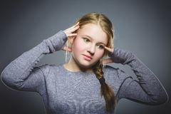 Closeup sad girl with worried stressed face expression stock photo