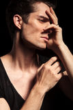 Closeup of a sad man with hands on his face Stock Photography