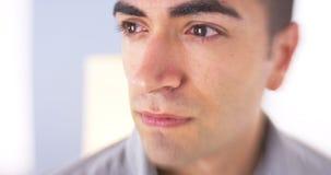 Closeup of sad Mexican man Stock Photo