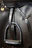 Closeup of saddle and riding tack. A closeup of saddle and riding tack clearly showing the stirrup royalty free stock photos