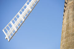 Closeup sail of historic windmill blue sky Stock Image