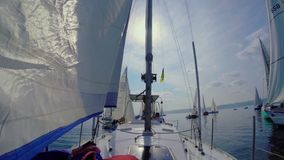 Closeup of sailing yacht in the sea, movement, speed, regatta. Stock footage stock video footage