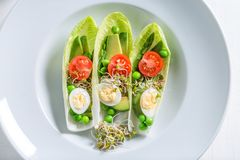Closeup of salad in chicory with avocado, asparagus and peas. On white table Stock Images