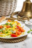 Closeup of salad with salmon and vegetables Royalty Free Stock Image