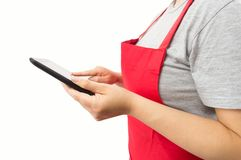 Saleswoman using the tablet. Closeup of saleslady using a tablet with white background Stock Photo