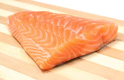 Closeup of salmon steak on wooden background Royalty Free Stock Photo