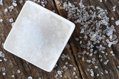 Closeup of salt on wooden table Stock Photography