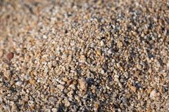 Closeup of sand on the beach. Crystals of sea sand as background. Macro royalty free stock photography