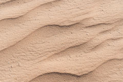 Closeup of sand pattern of a beach in the summer Stock Photography