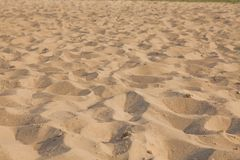 Closeup of sand pattern of a beach in the summer. Background.concept for summer season
