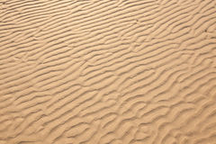 Closeup of sand pattern of a beach Royalty Free Stock Photography