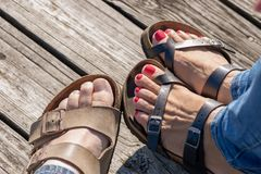 Closeup of sandals on wood pier royalty free stock photo
