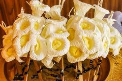 Closeup Sandalwood flowers or artificial flowers on the golde. Closeup of Sandalwood flowers or artificial flowers on the golden tray with pedestal Stock Photography