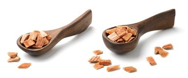 Closeup of sandalwood in the wooden spoon, isolated on white. Closeup of sandalwood in the wooden spoon, isolated Stock Photos