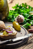 Closeup of sandwich with gherkin, lard and onion Royalty Free Stock Photos