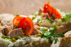Closeup of sandwich made of cottage cheese, tuna and tomato royalty free stock image