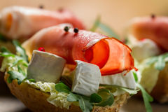 Closeup of sandwiches made of parma ham and brie cheese stock image