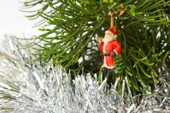 Closeup of Santa claus dall on  Christmas tree. Royalty Free Stock Image