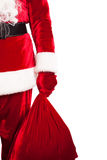 Closeup of Santa Claus hand holding red sack royalty free stock images