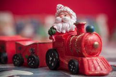 Santa claus on miniature toy train. Closeup of santa claus on miniature toy train Stock Image