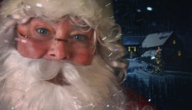Closeup of Santa Claus with night scene in background Stock Photo