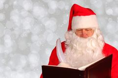 Santa Claus with Naughty and Nice Book with Copy Space royalty free stock photo
