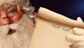 Closeup of Santa Clause holding scroll Royalty Free Stock Photo