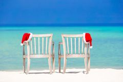 Closeup santa hat on chair on tropical white beach Royalty Free Stock Photos