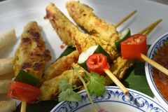 Closeup of satay chicken in a restaurant in Thailand stock photo