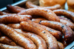 Closeup of sausage on the grill Royalty Free Stock Images