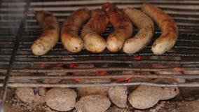 Closeup of Sausages roasting stock video footage