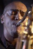 Closeup Of Saxophone Player. Closeup of an African American man playing saxophone Royalty Free Stock Images