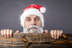 Closeup of a  scared man with frozen beard and moustache wearing Stock Photos
