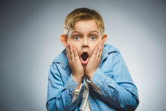 Closeup Scared and shocked little boys. Human emotion face expression Stock Photo