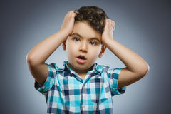 Closeup Scared and shocked little boys. Human emotion face expression Royalty Free Stock Photo