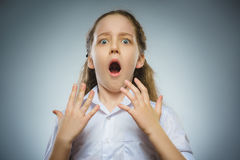 Closeup Scared and shocked little girl. Human emotion face expression.  stock photos