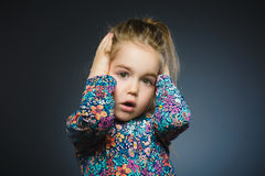 Closeup Scared and shocked little girl. Human emotion face expression Stock Image