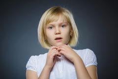 Closeup Scared and shocked little girl. Human emotion face expression.  royalty free stock photography