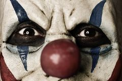 Closeup of a scary evil clown. With a disturbing look in his eyes Stock Images