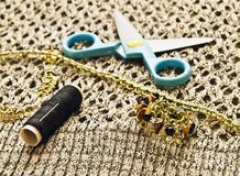 Closeup scissors, threads and beads Stock Image