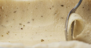 Closeup of scooping lemon mint sorbet with spoon. Wide photo Stock Photography