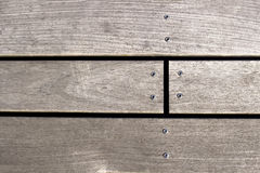 Closeup of a screw screwed into wooden plank. Top view with copy space Royalty Free Stock Photography