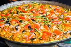 Closeup of Seafood Paella in a large frying pan. royalty free stock image
