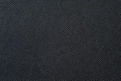 Closeup of seamless black leather texture. For background stock photography