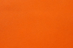 Closeup of seamless orange leather texture. For background royalty free stock photography