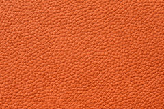 Closeup of seamless orange leather texture. For background royalty free stock image
