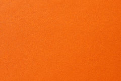 Closeup of seamless orange leather texture Stock Image